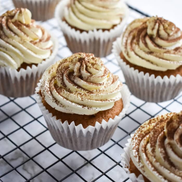 Cappuccino Cupcakes with Milk Icing on a cooling rack