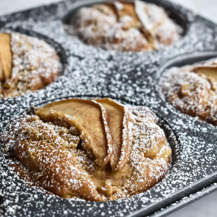 spiced pear muffins in a jumbo muffin tin