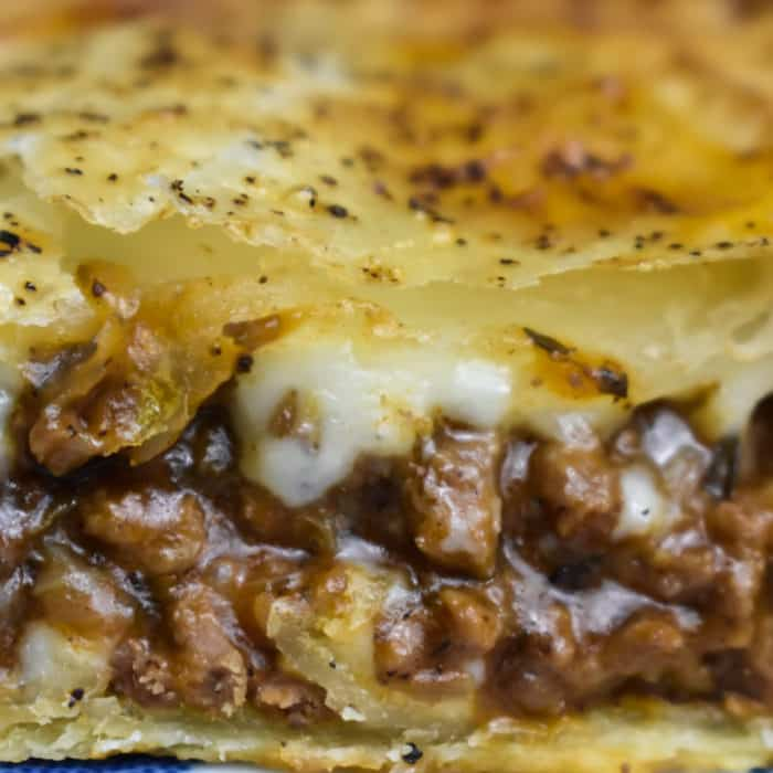 Mince and Cheese Pie cut in half and on a plate