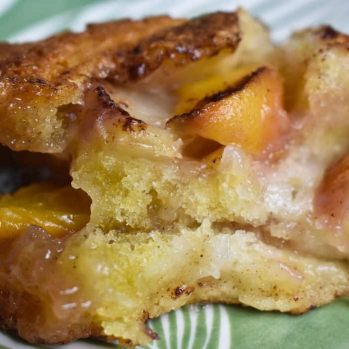 Peach Cobbler on a green plate.
