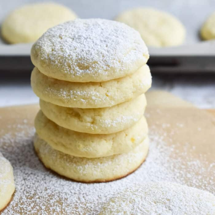 cream cheese cookies on a wooden chopping board