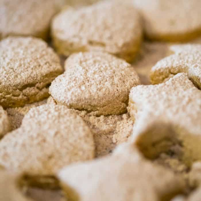 cookies on a tray with icing sugar